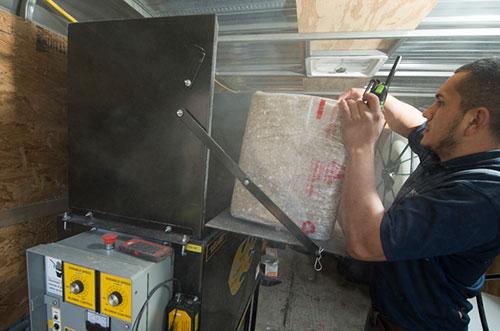 A man installing fiberglass insulation